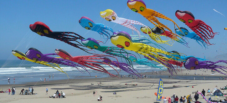 Flying kites on the beach located near our lincoln city vacation rentals